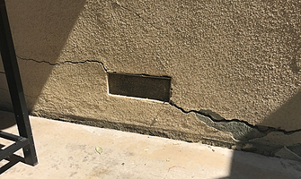 cracked stucco wall
